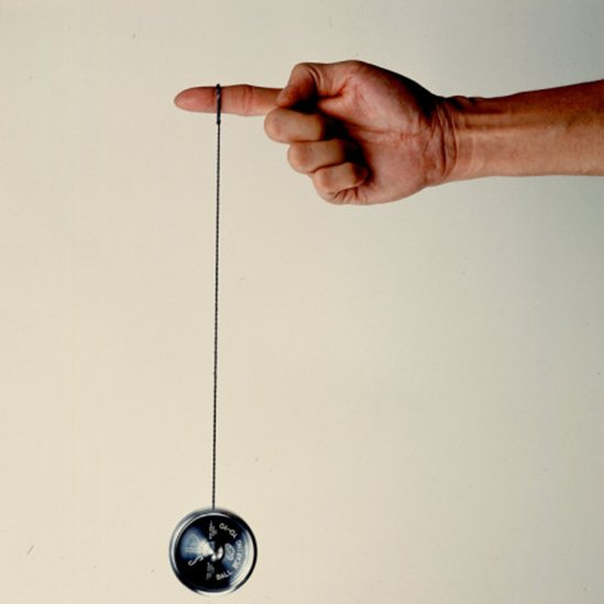 ted-thai-hand-holding-string-attached-to-tom-khun-yo-yos-ltd-s-high-tech-aluminum-ball-bearing-yo-yo.jpg